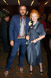 Top British fashion designer VIVIENNE WESTWOOD and her husband MR ANDREAS KRONTHALER at a party to celebrate the publication of Southwold - An Earthly Paradise by Geoffrey Munn and of Forty Years of The Antique Collectors Club at The Arts Club, 40 Dover Street, London W1 on 8th June 2006.<br /><br />NON EXCLUSIVE - WORLD RIGHTS
