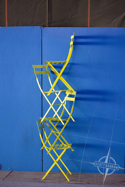 Brightly colored folding chairs.