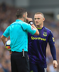 15 October 2017 -  Premier League - Brighton and Hove Albion v Everton - Wayne Rooney of Everton speaks to referee Michael Oliver - Photo: Marc Atkins/Offside