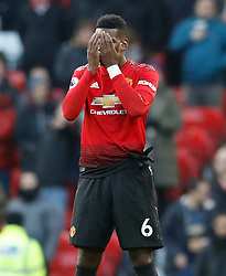 Manchester United's Paul Pogba covers his eyes