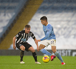 Joao Cancelo of Manchester City (R) in action - Mandatory by-line: Jack Phillips/JMP - 26/12/2020 - FOOTBALL - Etihad Stadium - Manchester, England - Manchester City v Newcastle United - English Premier League