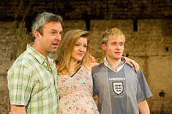 © Licensed to London News Pictures. 12/03/2012. London, UK. Southwark Playhouse presents the world premier of Philip Ridley's Shivered, directed by Russell Bolam. Picture shows Simon Lenagan as Mikey, Joseph Drake as Ryan and Olivia Poulet as Lyn. Photo credit : Tony Nandi/LNP