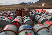 Rows of fuel drums outside the Polish Polar Station in Hornsund, Svalbard. The station operates year round and uses 90,000 liters of gasoline per year to operate generators, boats, snowmobiles, and heavy machinery.