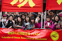 © Licensed to London News Pictures . 23/10/2015 . Manchester , UK . Crowds in Albert Square outside Manchester Town Hall as Chinese president , Xi Jinping , visits Manchester as part of his state visit to the United Kingdom . Photo credit: Joel Goodman/LNP