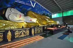 May 12, 2019 - Bogor, Indonesia - Buddhists Pray in Front of the 'Sleeping Buddha' Before Vesak Day at the Buddhist Dharma Temple and 8 Posat, Bogor, West Java, Indonesia, Sunday, May 12, 2019. (Credit Image: © Rangga Firmansyah/NurPhoto via ZUMA Press)