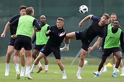 England's Gary Cahill (right) and Kieran Trippier (centre) during the training session at the Spartak Zelenogorsk Stadium, Repino.