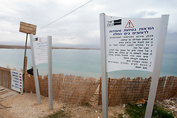 Sign at the Dead Sea. Train & Travel is a unique ten day program designed for IKMF's instructors, students & guests, interested in combining Krav Maga training with a tour of the holy land..©2011 Michael Schofield. All Rights Reserved.