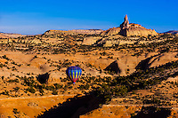 Aerial view of hot air balloons flying during the Red Rock Balloon Rally (Church Rock in background), Red Rock State Park, near Gallup, New Mexico USA.
