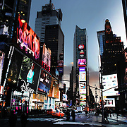 """A panoramic view of Times Square, the major commercial intersection in Midtown Manhattan, New York City, at the junction of Broadway and Seventh Avenue and stretching from West 42nd to West 47th Streets. Times Square, iconified as """"The Crossroads of the World"""" is the brightly illuminated hub of the Broadway theater district and one of the world's busiest pedestrian intersections. Times Square, New York, USA. Photo Tim Clayton."""
