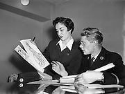 "12/11/1954<br /> 11/12/1954<br /> 12 November 1954 <br /> Aer Lingus workers Argina Galastegi and Bart Cronin prepare to stage ""Fly way Wild Eagle"", pictured here discussing details at  the Aer Lingus office on Cathal Brugha Street, Dublin."