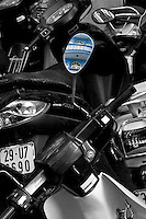 Classic architecture reflected in the rear view mirror of a parked motorbikes.