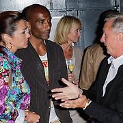 NLD/Amsterdam/20120531 - Presentatie kledinglijn Johan Cruijff Apparel Collection, Quinty trustfull en partner Orlando pratend met Johan, op de achterzijde zijn partner Danny Coster