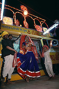 Evening entertainment with a transvestite at the Tilwara Camel and livestock Fair, Rajasthan, India.