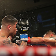 KISSIMMEE, FL - MARCH 06:  Juan Aguirre (R) catches Charles Natal with a jab during the Telemundo Boxeo boxing match at the Kissimmee Civic Center on March 6, 2015 in Kissimmee, Florida. (Photo by Alex Menendez/Getty Images) *** Local Caption ***  Charles Natal; Juan Aguirre