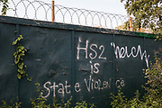 Graffiti reading 'HS2 Is State Violence' sprayed on boards around a construction site for the HS2 high-speed rail link in the Colne Valley is pictured on 11 September 2020 in Denham Green, United Kingdom. Anti-HS2 activists continue to try to prevent or delay works on the controversial £106bn HS2 high-speed rail link from a series of protection camps based along the route of the line between London and Birmingham.