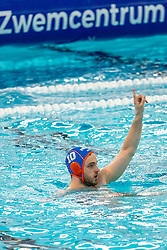 Pascal Janssen of the Netherlands in action against Montenegro during the Olympic qualifying tournament. The Dutch water polo players are on the hunt for a starting ticket for the Olympic Games on February 19, 2021 in Rotterdam