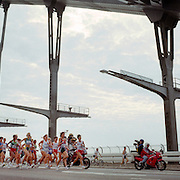 A panoramic image showing the Women's Marathon competitors in action as they run across the Sydney Harbour Bridge during the  2000 Sydney Olympic Games...Panoramic images from the Sydney Olympic Games, Sydney, Australia.  2000 . Photo Tim Clayton