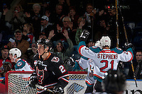 KELOWNA, CANADA - FEBRUARY 1: Devante Stephens #21 of the Kelowna Rockets raises his arms in celebration of a second period goal against the Calgary Hitmen on February 1, 2017 at Prospera Place in Kelowna, British Columbia, Canada.  (Photo by Marissa Baecker/Shoot the Breeze)  *** Local Caption ***