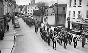 The St. patrick's Day parade makes its way up College Street, Killarney in the 1950's.<br /> Photo: macmonagle.com archive