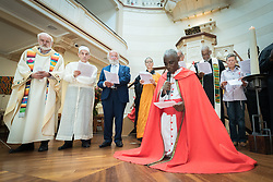 "23 July 2018, Amsterdam, the Netherlands: Rev. Canon Gideon Byamugisha, a founder of the International Network of Religious Leaders Living with or Personally Affected by HIV or AIDS (INERELA+), kneels in a concluding word of prayer. Gathered in a ""common voice"" religious leaders from a multitude of religions ""urgently demand that the world recommit to ending AIDS and that world leaders take strong action to ensure this epidemic is finally brought to an end."" On 23 July, an international Interfaith Memorial and Prayer Service takes place in the Keizersgrachtkerk in Amsterdam, the Netherlands. Gathering local congregants together with international guests, the service takes place in connection with the 2018 International AIDS Conference, held in Amsterdam on 23-27 July."