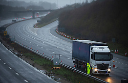 © Licensed to London News Pictures. 21/12/2020. Hollingbourne, UK. Police stop a lorry on an empty M20 in Kent, A major police operation is underway in Kent as Operation Stack is implemented on the M20 due to the Port of Dover and Channel Tunnel having to close in response to France closing its borders to the UK.  All freight and passenger traffic have been banned for 48 hours due to the new mutant strain of the Coronavirus in England. traffic. Photo credit:Grant Falvey/LNP