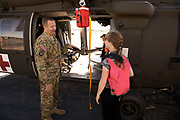 Visitors check out a Blackhawk and talk to the crew at Warbirds Over the West.
