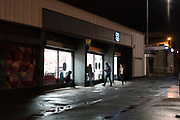 Youths playing in the streets at night. Kirkcaldy is one of the poorest areas in Scotland with staggeringly high numbers of child poverty. Many disadvantaged families, and vulnerable people, and over a thousand children are surviving below the breadline in Kirkaldy East, that is 40%. Voluntary organisations and foodbanks give over a thousand food parcels a month, several times more than a few years ago. The Conservative government's policy of austerity together with the new 'Universal Credit' system which replaced six other benefits, makes millions of people poorer, many hundreds of thousands on the poverty line or below. Whilst people overall voted strongly against Brexit in Scotland, in other parts of the country, poorer constituencies voted largely for Brexit, in a vote against the City of London.