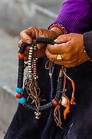 Tibetan woman holding her prayer beads, The Barkhor, Old Lhasa, Tibet (Xizang), China.