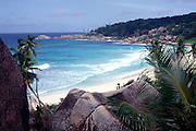 Tropical paradise landscape with blue sea, bay, palm trees and sandy Anse Major beach, La Digue island, Seychelles