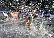 Lisa Lauschke of Kansas competes in the steeplechase during the Big 12 Outdoor Track & Field Championship at R.V. Christian Track & Field Complex in Manhattan, Kansas.