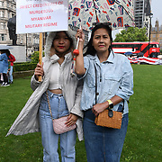 Burmanese standing in the rain Commemorating 33 years of the 8888 Uprising & Struggle for Democracy on 8 August 2021, London, UK.