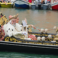 VENICE, ITALY - SEPTEMBER 04:  A couple wearing costumes of the Venetian Doge and Dogaressa in a gondola take part in the Historic Regata on September 4, 2011 in Venice, Italy. The Historic Regata is the most popular boat race on the Gran Canal for locals and tourists alike.