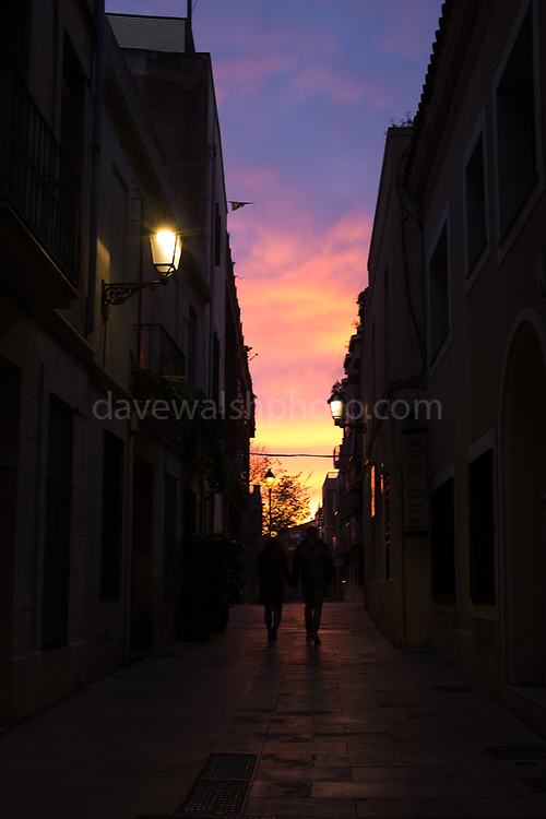 "A couple walk into the winter Sunset in a Carrer de Negrevernís in Sarria, Barcelona, December 2nd 2017 This mage can be licensed via Millennium Images. Contact me for more details, or email mail@milim.com For prints, contact me, or click ""add to cart"" to some standard print options."