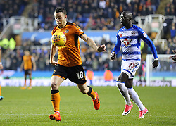 Wolves Diogo Jota beats Reading's Modou Barrow to the ball during a drop kick during the Sky Bet Championship match at the Madejski Stadium, Reading.