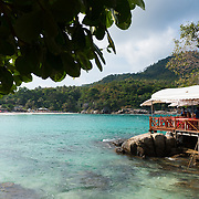 Raya resort restaurant on rocks in Batok bay, Raya island, Thailand