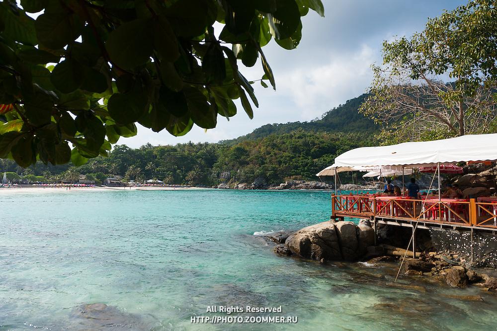 Raya resort restaurant on rocks in Batok bay, Raya island, Thailand