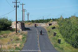 """Randy Aron riding his 1929 Harley-Davidson JD named """"Lucille"""" along with some friends through apple orchards during Stage 15 (244 miles) of the Motorcycle Cannonball Cross-Country Endurance Run, which on this day ran from Lewiston, Idaho to Yakima, WA, USA. Saturday, September 20, 2014.  Photography ©2014 Michael Lichter."""