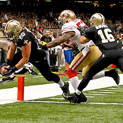 November 25, 2012; New Orleans, LA, USA; New Orleans Saints fullback Jed Collins (45) scores past San Francisco 49ers inside linebacker NaVorro Bowman (53) during the third quarter of a game at the Mercedes-Benz Superdome. The 49ers defeated the Saints 31-21. Mandatory Credit: Derick E. Hingle-US PRESSWIRE