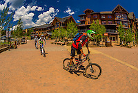 Mountain bikers, Base Village,  Snowmass Village (Aspen), Colorado USA.