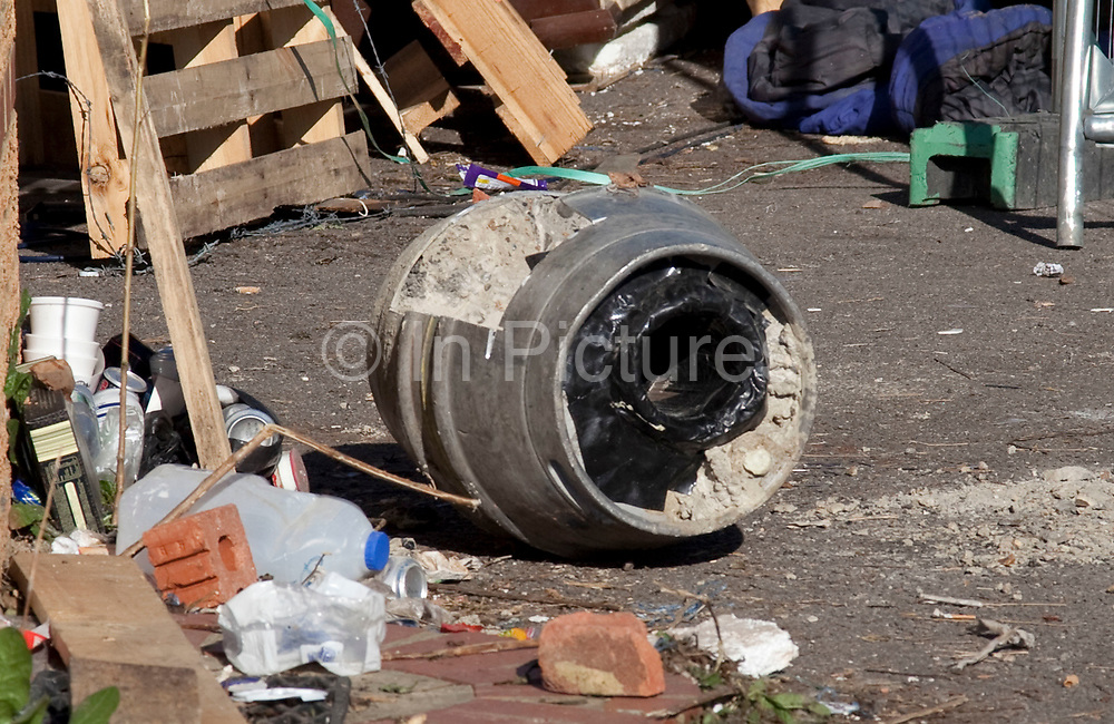 Barrel which held together two protesters, full of concrete and locks. Travellers at Dale Farm site prior to eviction. Riot police and bailiffs were present on 20th October 2011, as the site was cleared of the last protesters chained to barricades. Dale Farm is part of a Romany Gypsy and Irish Traveller site in Crays Hill, Essex, UK<br /> <br /> Dale Farm housed over 1,000 people, the largest Traveller concentration in the UK. The whole of the site is owned by residents and is located within the Green Belt. It is in two parts: in one, residents constructed buildings with planning permission to do so; in the other, residents were refused planning permission due to the green belt policy, and built on the site anyway.