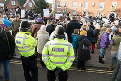 © Licensed to London News Pictures. 26/12/2017. Market Bosworth, Leicestershire, UK. The Hunt meeting in the Market Square, Market Bosworth earlier today. Pictured, Anti-hunt protesters were closely monitored by the police and told to keep quiet when the horses arrived in the square. Photo credit: Dave Warren/LNP