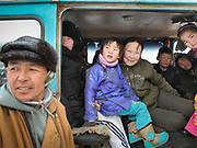 Mongolians traveling in the Gobi Gurvan Saikhan national park. Road trip with a Jeep.