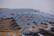 YANTAI, CHINA - NOVEMBER 17: (CHINA OUT) <br /> <br /> Terrestrial Photovoltaic Power Project Built<br /> <br /> polycrystalline silicon solar panels as terrestrial photovoltaic power project starts in Guanshui Town of Muping District on November 17, 2015 in Yantai, Shandong Province of China. The project covering more than 300 arces of barren hills began in July and was expected to completed by end of the year, with a total installed capacity of 40 megawatts.<br /> ©Exclusivepix Media
