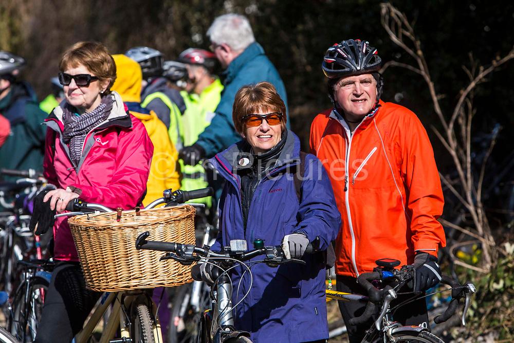 An excited maturer couple wait amongst a large group of cyclists for the official opening of the Devonshire Tunnel as part of the Bath Two Tunnels Greenway on 6th April 2013.  he iconic tunnels provide a fantastic walking and cycling link between Central Bath, Midford, Monkton Combe and beyond.  The restoration of these tunnels has opened up a 13 mile circular route from the centre of Bath that takes in National Cycle Route 24, National Route 4 and the spectacular Dundas Aqueduct on the Kennet & Avon Canal.  This development was started by a local community group and is part of the Sustrans lottery-funded project, Connect 2 Cycling Network.  Hundreds of people attended the event. Bath, Somerset, United Kingdom.