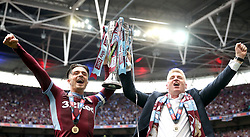 Aston Villa's Jack Grealish (left) and manager Dean Smith celebrate lifting the Sky Bet Championship Play-off Final Trophy after the final whistle