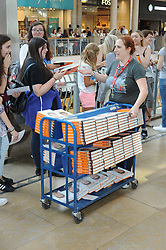 © Licensed to London News Pictures. 08/08/2015 <br /> Staff handing out pre ordered signed books.<br /> Blogger MARCUS BUTLER at Waterstones bookshop in Bluewater,Kent today meeting fans and signing copies of his book.<br /> (Byline:Grant Falvey/LNP)