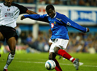 Fotball<br /> England<br /> Foto: SBI/Digitalsport<br /> NORWAY ONLY<br /> <br /> Portsmouth v Fulham<br /> <br /> Barclays Premiership. 30/08/2004<br /> <br /> Aiyegbeni Yakubu of Portsmouth scores the third goal to make it 3-0 to Portsmouth as Zat Knight of Fulham can only look on