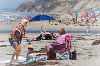 Man sunning at the beach. Torrey Pines Beach, San Diego California, USA.