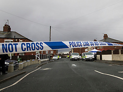 © London News Pictures. 27/03/2016. Leeds, UK. Police and forensics at the scene where two women and a man have been found dead at a property in East End Park area of Leeds. Police believed the deaths occurred in the early hours of Saturday. Photo credit: Eddy O'Beirne/LNP