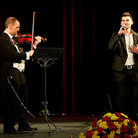 Lajos Palasti sings his song from You can be a star in China while Csongor Veer plays the violin during the lunar new year gala program organized by the Confucius Institute of ELTE University in Budapest, Hungary on February 16, 2011. ATTILA VOLGYI